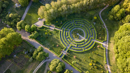 Aerial view a natural labyrinth in the botanical garden on a sunny day