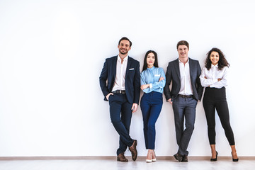 The business people standing on the white wall background Wall mural