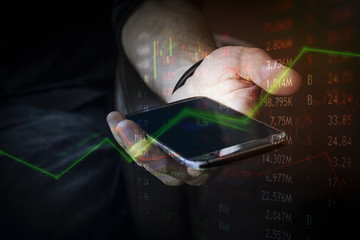 Financial investor with mobile device for business and connected to the market instantly around the globe for buying and selling.