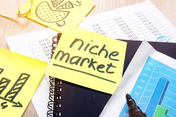 Niche market written on a memo stick.