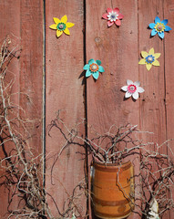 In the village garden installation dry branches and homemade plastic flowers are used.