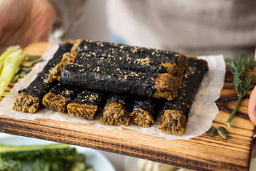Vegan bread sticks wrapped in seaweed with flax seeds, spices, herbs. raw, vegan, vegetarian food concept.