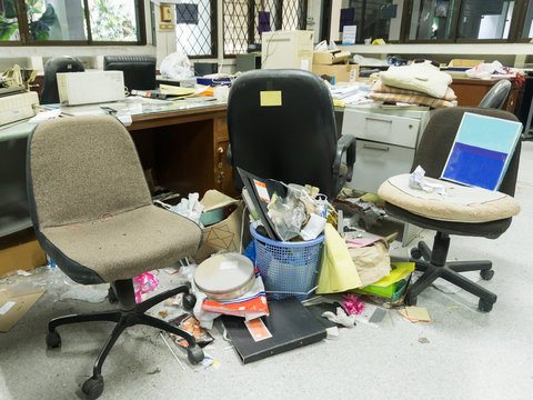 Dirty, messy and abandoned office, poor light