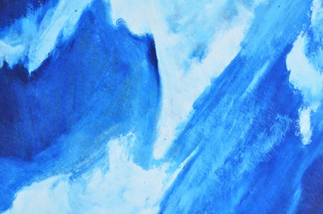 Light blue and white smears of watercolor paint on a thick canvas