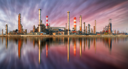 Oil Refinery at sunset with reflection