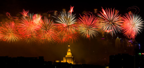 Fireworks on National Day celebration at Doha Qatar with Islamic Cultural Center Fanar building in background