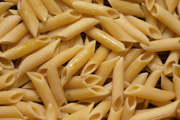Many pasta pieces on a metal background. Selective focus. Shallow depth of field. Toned