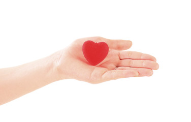 Hand holding red heart on white background. Valentine's Day