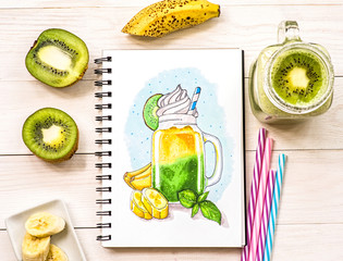 a hand-drawn illustration wth milkshake in mason jar ina sketchbook decorated with a milkshake cocktail, kiwis, bananas and drinking straws on white wood background