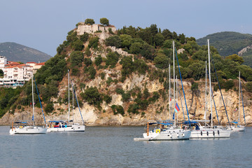 Yachts sail near Parga fortress Greece summer season