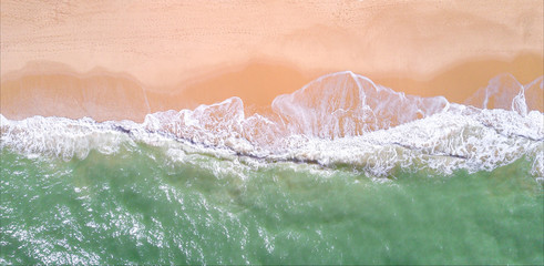 Wall Mural - Aerial view of tropical sandy beach and ocean. Copy space