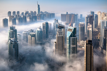 Papiers peints Dubai Dubai skyline, an impressive aerial top view of the city in Dubai Marina on a foggy day