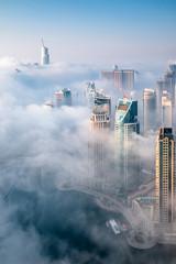Dubai skyline, aerial top view of the city in Dubai Marina on a foggy day