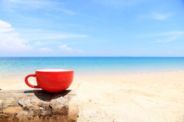 Red Coffee Cup on the beach minimal style and Copy space