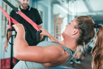 Personal trainer with woman in the gym
