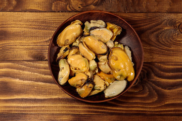 Marinated mussels on wooden table