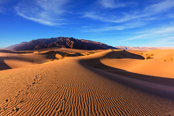 Waves of orange sand