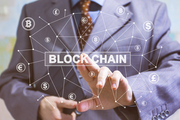 Businessman presses button blockchain on virtual web digital electronic user interface