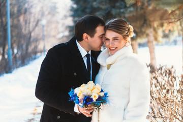 Winter bright wedding bride and groom couple