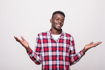 Portrait of young african american man gesturing do not know sign with confused expression isolated on white background