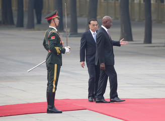 China's Premier Li Keqiang and Trinidad and Tobago Prime Minister Keith Rowley attend a welcoming ceremony in Beijing