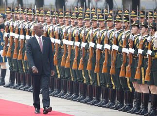 Trinidad and Tobago Prime Minister Keith Rowley inspects honour guards during a welcoming ceremony in Beijing