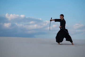 Foto op Aluminium Vechtsport Focused man, in traditional Japanese clothes, is practicing martial arts