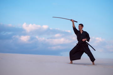 Garden Poster Martial arts Man is practicing with a Japanese sword - a katana