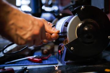 Photo of man sharpening tool