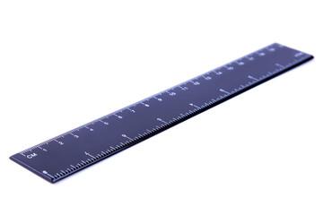 Black ruler on white background