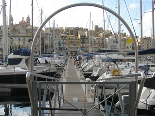 A lot of magnificent boats and yachts await sailing in the harbor of Valletta.
