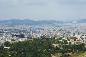 View from above on the streets and roofs of the houses of a modern European city. Athens summer day from a height.