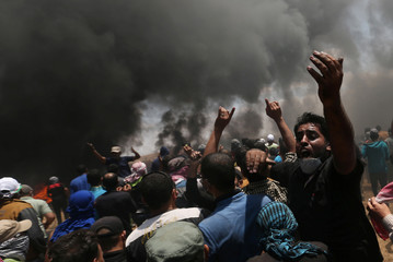 Palestinian demonstrator reacts during a protest in the southern Gaza Strip