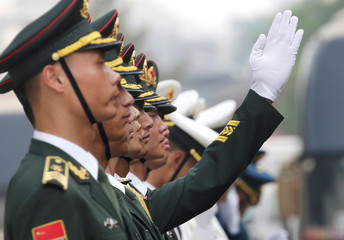 Soldiers from honour guards practice ahead of a welcoming ceremony in Beijing