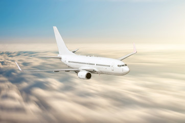 Airplane in the sky above the clouds flight journey sunset height speed motion blur.