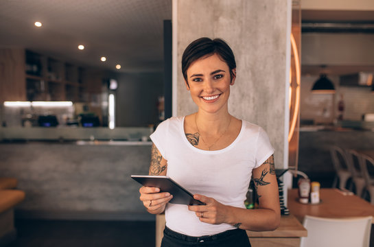 Female restaurant owner with a digital tablet