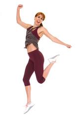 Attractive older woman in sportswear jumping