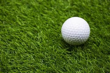 Golf ball is on green grass