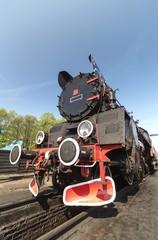 retro steam train on blue sky