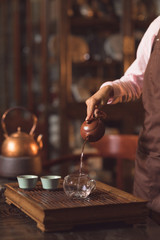Tea master pouring tea indoors