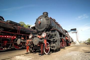 old steam train locomotive on blue sky