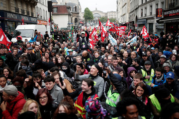 French state-owned SNCF railway company employees and labour union members demonstrate as part of a nationwide strike in Paris