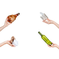 Hands holding crumpled paper, empty glass and plastic bottles, tin can isolated on white background. Copyspace for text. Recycling, reuse, garbage disposal, resources environment and ecology concept.