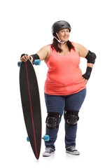 Overweight woman wearing protective gear and holding a longboard