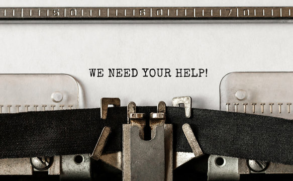Text We Need Your Help typed on retro typewriter