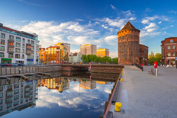 Beautiful old town of Gdansk reflected in Motlawa river at sunrise, Poland.