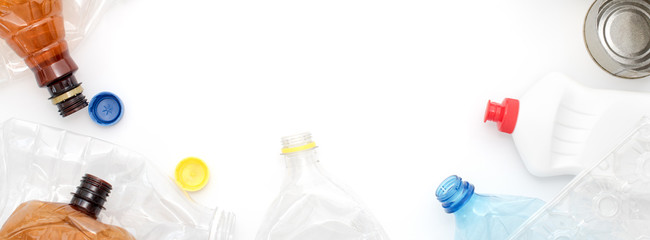 Recyclable waste, resources. Clean plastic and metal on white background. Copyspace for text. Recycling, reuse, garbage disposal, resources, environment and ecology concept.