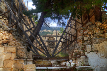 Fotobehang Rudnes The ancient ruin of the monastery of Sisia on Cephalonia, heavily damaged by the 1953 earthquake, barely holding together, wooden struts all over.