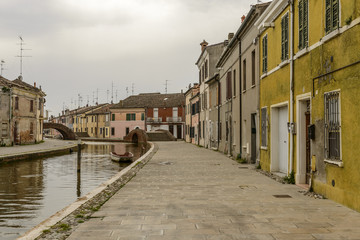 canal and embankment in san Pietro street, Comacchio, Italy