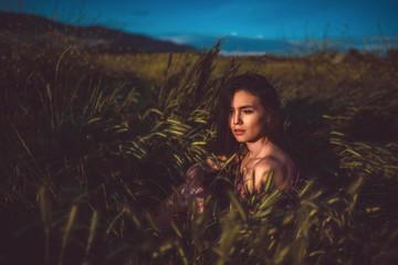 girl in red in a wheat field